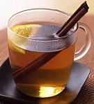 tea with lemon wedge cinnamon stick stirrer