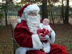 Robert sitting on Santa's lap for the first time
